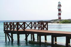 Beach bridge and lighthouse in Cancun, Mexico Stock Images