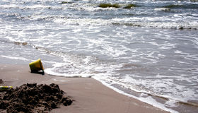 Beach and the bucket Royalty Free Stock Images