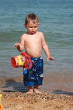 Beach bucket levitation. A little boy holding his red bucket in levitation Stock Photo