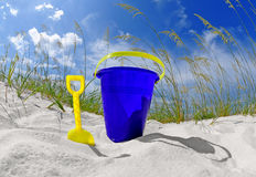 Beach bucket on sand dune Stock Photography