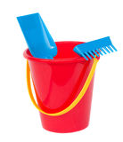 Beach bucket with spades. Beach bucket spades in blue and red colours isolated on white background Stock Images