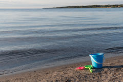 Beach with bucket and spades. Sand beach with plastic bucket and spades Stock Photo