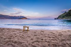 Beach in Budva. Evening view from small Mogren Beach with Island of Saint Nicholas in Budva, Montenegro Royalty Free Stock Image