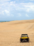 Beach buggy in sand dunes. Under blue sky Royalty Free Stock Image