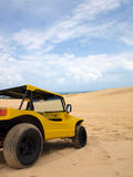 Beach buggy in sand dunes. Under blue sky Royalty Free Stock Photography