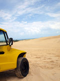 Beach buggy in sand dunes. Under blue sky Stock Photography