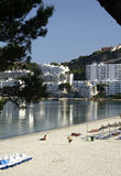 Beach and buildings at Majorca. A pretty view of the beach and white high rise apartment and condo buildings along the shoreline of the Spanish island of Majorca Stock Photography