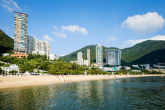 The beach and the buildings of Repulse Bay, Hong Kong. Stock Images