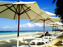 Beach chair and umbrellas. Rows of lounge chair on the beach - Boracay, Philippines royalty free stock photos