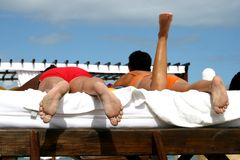 Beach Bums. Couple tanning in the tropics Stock Photo