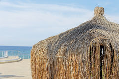 Beach Bungalow Closeup. With Blue Sky Background Stock Images