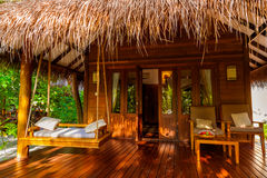 Beach bungalow - Maldives. Vacation background Stock Images