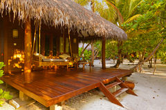 Beach bungalow - Maldives. Vacation background Royalty Free Stock Photos