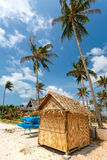 Beach, bungalow, palm tree Stock Photos