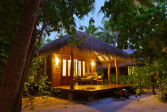 Beach bungalow at sunset - Maldives Royalty Free Stock Image