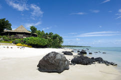 Beach bungalow in tropical pacific ocean Island. Stock Photo