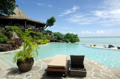 Beach bungalow in tropical pacific ocean Island. Royalty Free Stock Images