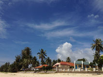 Beach bungalows Stock Images