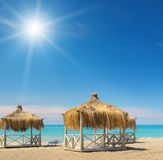 Beach, bungalows,  sky and sun Stock Photos