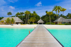 Beach bungalows on a tropical island. Travel background Royalty Free Stock Photos