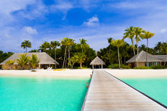 Beach bungalows on a tropical island Royalty Free Stock Images