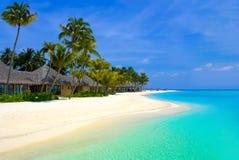Beach bungalows on a tropical island Stock Photo