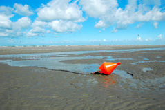 Beach buoy. An orange buoy on the beach of oostduinkerke,  belgium Stock Photo