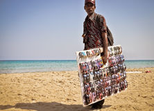 Beach business. Sunglasses salesman Royalty Free Stock Photo