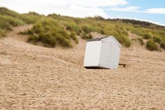 A beach cabin overthrown by a storm Stock Images