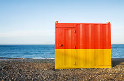 Beach cabin at sunset. Summer vacation - red and yellow beach cabin Royalty Free Stock Images