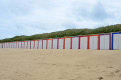 Beach cabines in the sand Holland Stock Photography