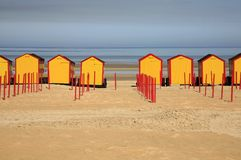 Beach Cabins on the beach of De Panne, seaside res Stock Photos
