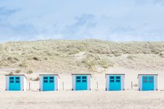 Beach cabins ,Texel, The Netherlands. Little white blue cabins at the beach of Texel. The largest wadden island of the Netherlands stock images