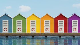 Beach cabins on wooden pier. Colorful beach cabins on an old wooden pier - 3D Rendering Royalty Free Stock Image