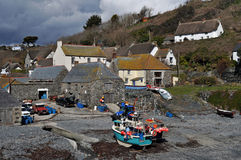 Cadgwith Cove Cornwall. The beach at Cadgwith Cove provides a safe haven for fishing boats, hauled ashore by wich and chain Royalty Free Stock Images