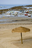 Beach in Cadiz on low tide. A sunshade on the beach of Cadiz Stock Images
