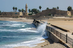 The Beach at Caesarea. The Mediterranean Sea strikes the sea wall at Caesarea in Israel Royalty Free Stock Photos