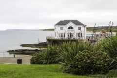 Beach cafe Arcadia at Portrush bay. Portrush, UK - July 1, 2017: Beach cafe Arcadia at seaside, County Antrim, Northern Ireland Stock Photography