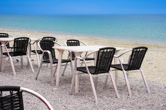 Beach cafe with empty tables and chairs Royalty Free Stock Images