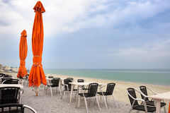 Beach cafe with empty tables and chairs Stock Images