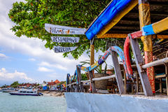 Beach cafe with outriggers from old traditional Indonesian longtail boats as handrails Nusa, Lembongan, Indonesia. Beach cafe with outriggers from old Royalty Free Stock Images