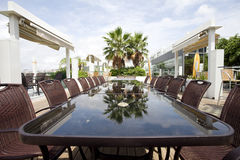 Beach cafe with  tables and chairs Royalty Free Stock Images