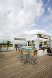 Beach cafe with  tables and chairs Royalty Free Stock Photography