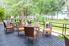 Beach cafe with tables and chairs placed at the sea waterfront Royalty Free Stock Image