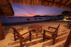 Beach cafe with wooden tables and chairs Stock Photography