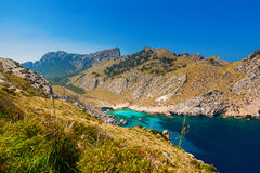 The beach Cala Figuera among hills in cape Formentor. Beautiful view of the beach Cala Figuera among hills in cape Formentor, Mallorca, Spain Stock Photos