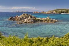 Beach of Cala Trinità in Maddalena island, Sardinia, Italy. Rocks, trees and blue sea of Cala Trinità - La Maddalena, North Sardinia, Italy. Paradise Royalty Free Stock Images