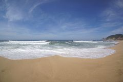 Beach California. A beach in California with waves rolling in Royalty Free Stock Photos