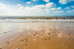 Beach. Calm beach, blue sky and white clouds on a sunny day Stock Photography