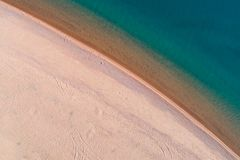 Beach and Calm Sea. Aerial Vertical Top-Down View royalty free stock image